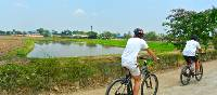 The roads between Northern Bangkok and Ayutthaya behind the handlebars, rural Thailand | Sue Badyari