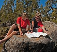 Enjoying the sunshine, reading maps on a Tasmanian Expeditions trek |  <i>Don Fuchs</i>