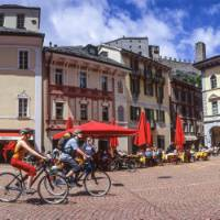 Cycle through quaint old villages on your way to one of the lakes in the Ticino region of Switzerland