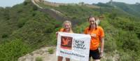 Fundraisers holding the Huma banner on the Great Wall Open Challenge | Claire Smart