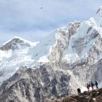 Trekkers dwarfed by the mountains of the Everest Region in Nepal | Ayla Rowe