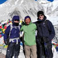 Local guide and trekkers smiling for photo |  <i>Heike Krumm</i>