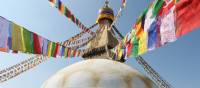 Prayer flags hang from the Boudhanath stupa in Kathmandu | Ayla Rowe